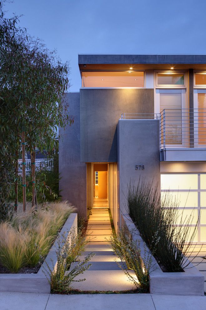 Asphalt vs Concrete for a Contemporary Exterior with a Minimalism and Oliveras by Kkc Fine Homes