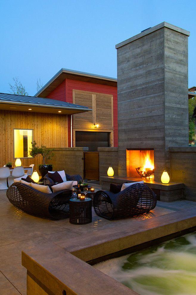 Asphalt vs Concrete for a Contemporary Patio with a Concrete Fireplace and Modern Patio by Rcodesigners.com