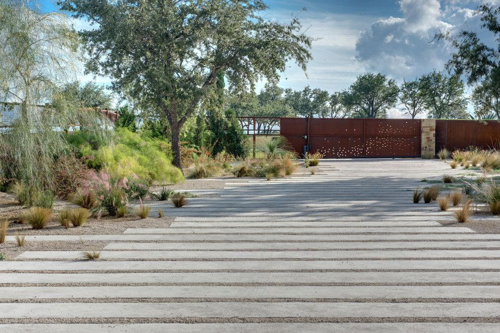 Asphalt vs Concrete for a Modern Landscape with a Rust and Portfolio by D Crain Design and Construction