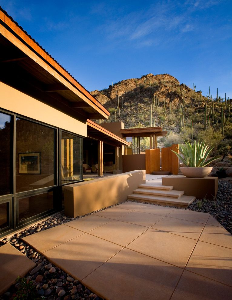 Asphalt vs Concrete for a Southwestern Patio with a Rusted Steel and Rancho Nuevo by Bianchi Design