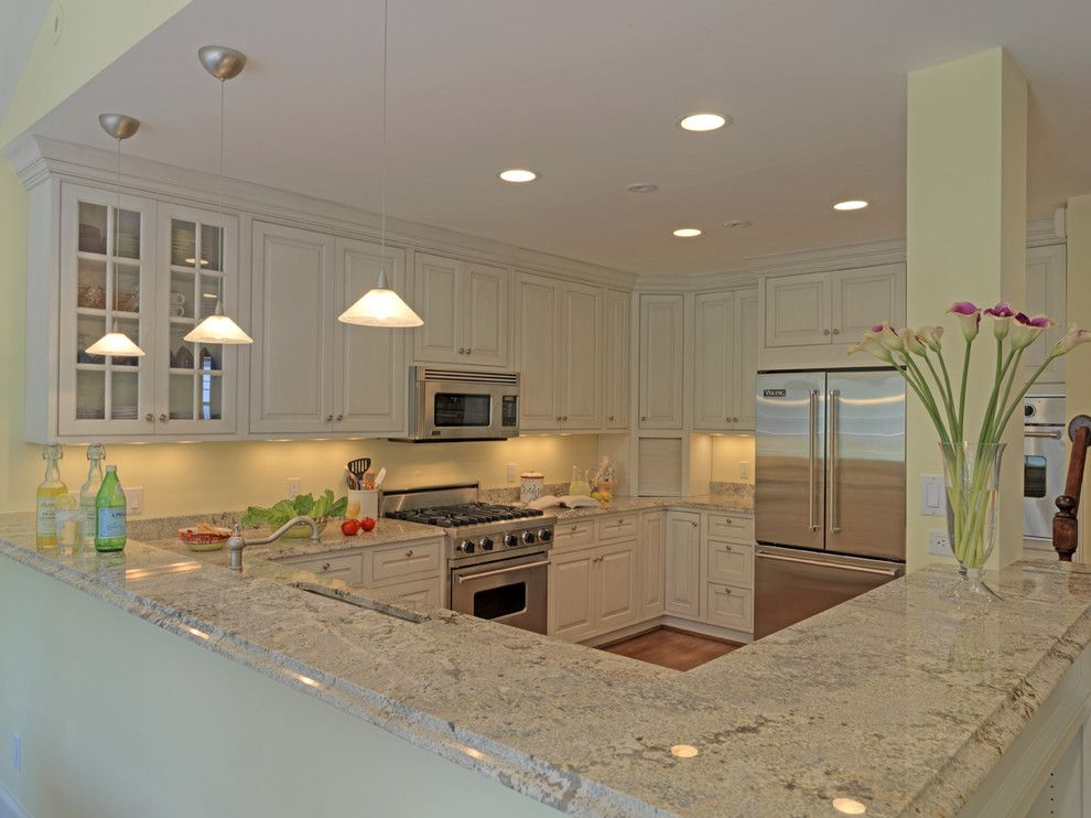 Astoria Granite For A Traditional Kitchen With A Wood Cabinets And Case Design Remodeling Inc