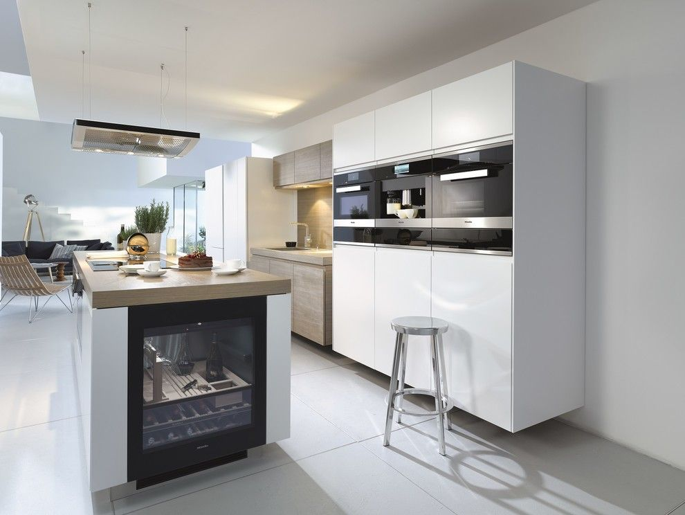 Atherton Appliance for a Modern Kitchen with a Wine Refrigerator and Miele by Miele Appliance Inc