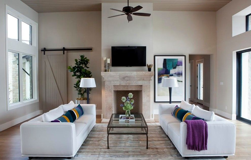Austin Hardwoods for a Contemporary Family Room with a Barn Door and Barton Creek One by Kim Ledlie Design