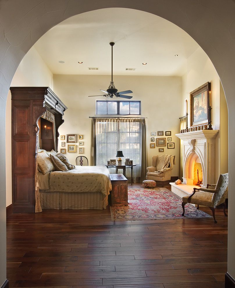 Austin Hardwoods for a Mediterranean Bedroom with a Dark Floor and Lake Home Master Bedroom by Cornerstone Architects