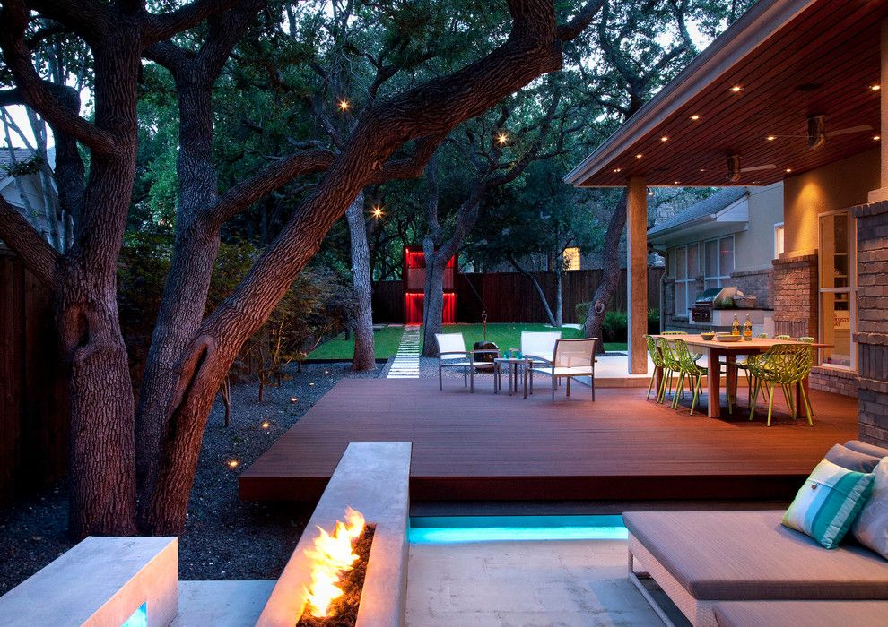 Backyard Masters for a Contemporary Landscape with a Stone Patio and Live Eat Relax and Play in the Back Yard by Austin Outdoor Design