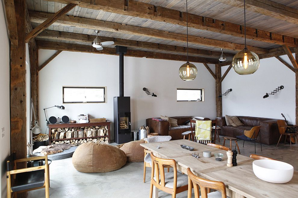 Bacons Furniture for a Rustic Living Room with a Sconce and Bovina House by Kimberly Peck Architect