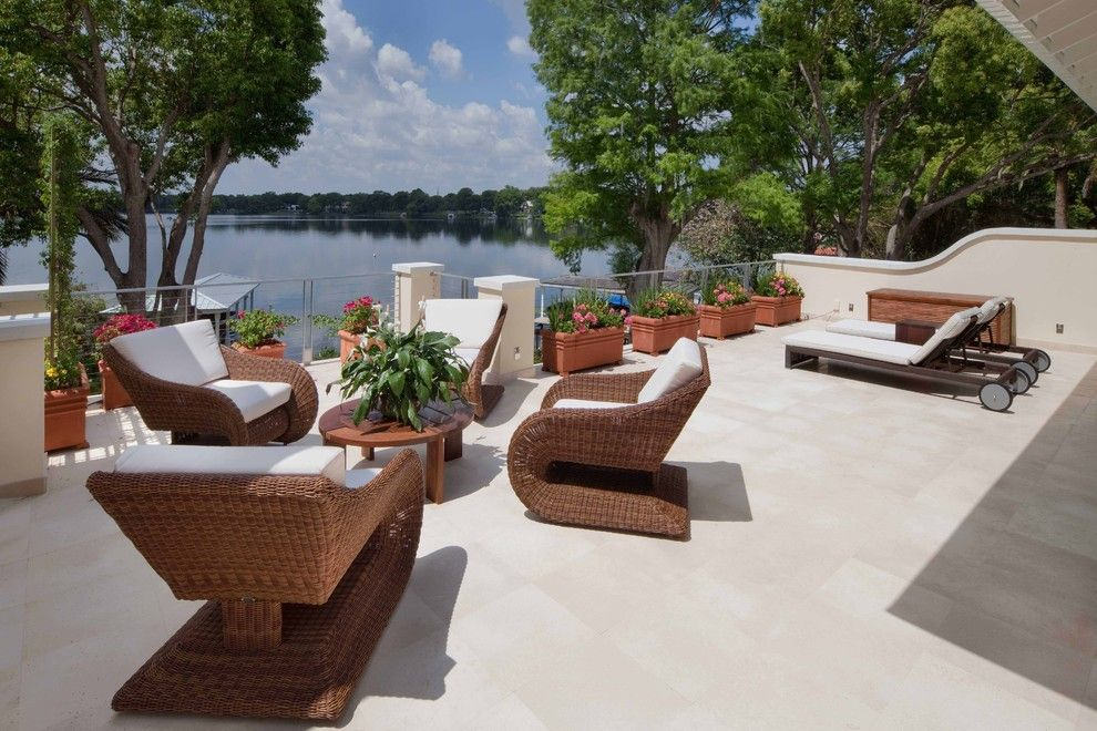 Bacons Furniture for a Tropical Patio with a Lake and La Belle by Phil Kean Design Group