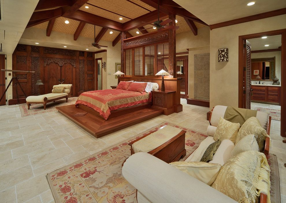 Balis for a Tropical Bedroom with a Carved Wood Bed and Bali House by Rick Ryniak Architects
