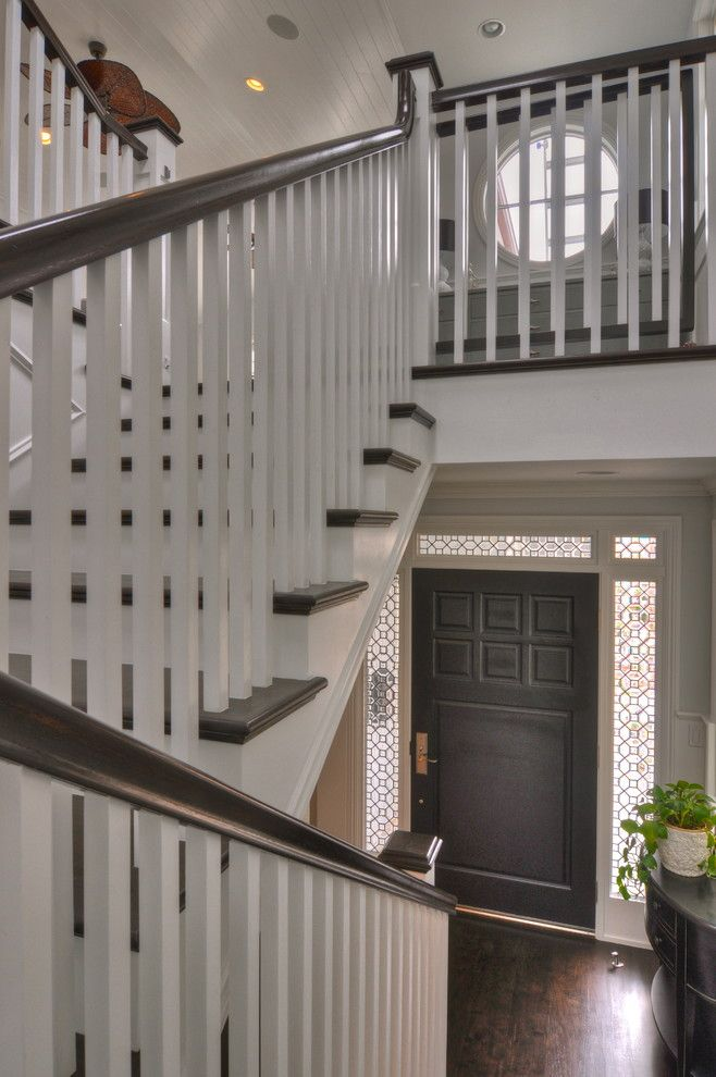 Ballister for a Traditional Staircase with a Wood Banister and Freestone Residence by Luann Development, Inc.