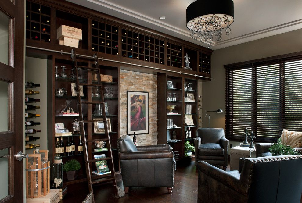Barden Homes for a Contemporary Wine Cellar with a Black Drum Pendant Light and Kingsridge Model by Moceri Homes