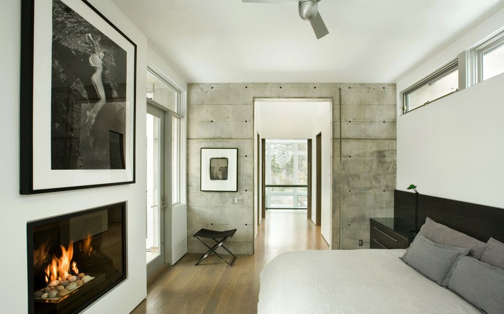 Bare Bones Furniture for a Modern Bedroom with a Concrete Wall and Capitol Creek by Kaegebein Fine Homebuilding