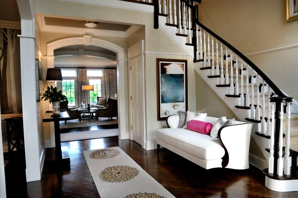 Bare Bones Furniture for a Traditional Entry with a Dark Wood Stairs and Foyer by a Perfect Placement