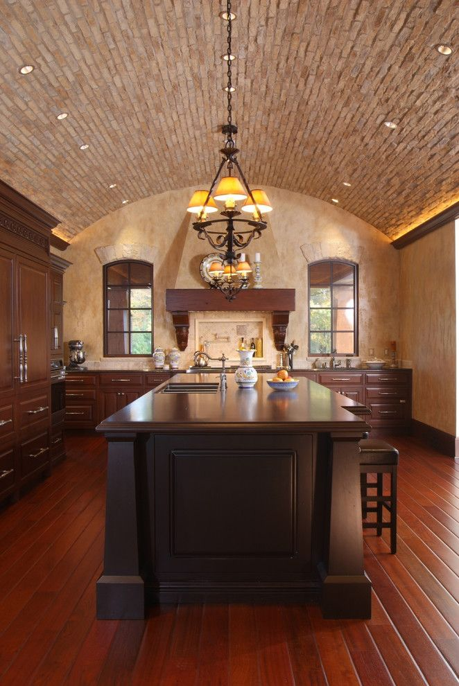 Barrel Vault for a Mediterranean Kitchen with a Chandelier and Kitchen by Visbeen Architects