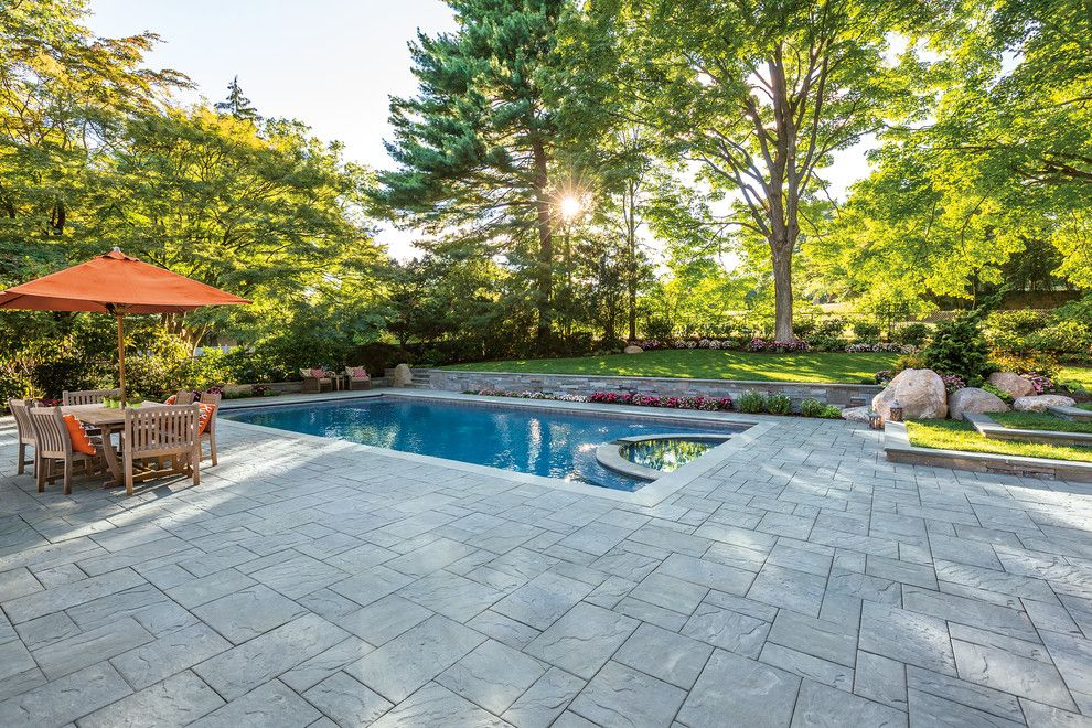 Barrington Pools for a Contemporary Spaces with a Wood Dining Chair and Cambridge Pavingstones with Armortec by Cambridge Pavingstones with Armortec
