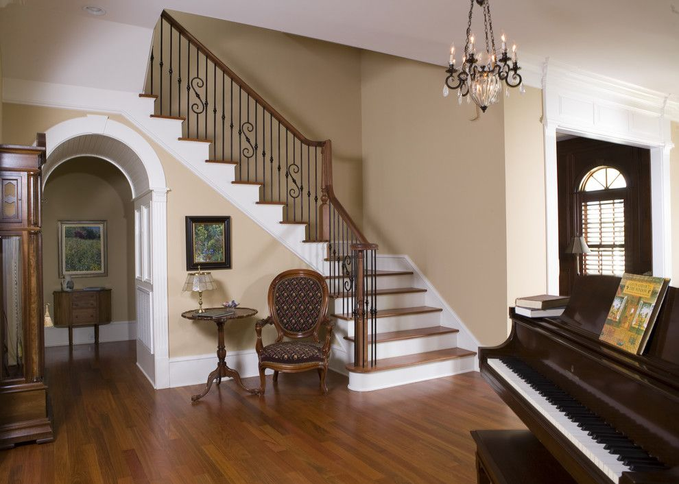 Bassett Mirror Company for a Traditional Entry with a Banister and Manning Residence Foyer and Stairway by Max Crosby Construction
