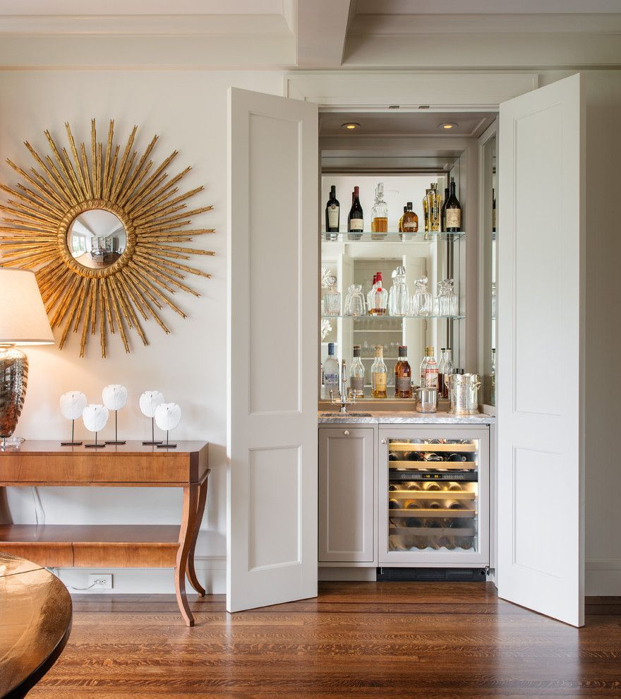 Bassett Mirror Company for a Transitional Home Bar with a Beige Wall and Clay Street by Sutro Architects
