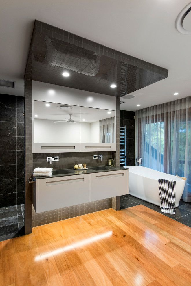 Bathroom Layouts for a Contemporary Bathroom with a Black Countertop and Contemporary Queensland Bathroom Design by Darren James Interiors