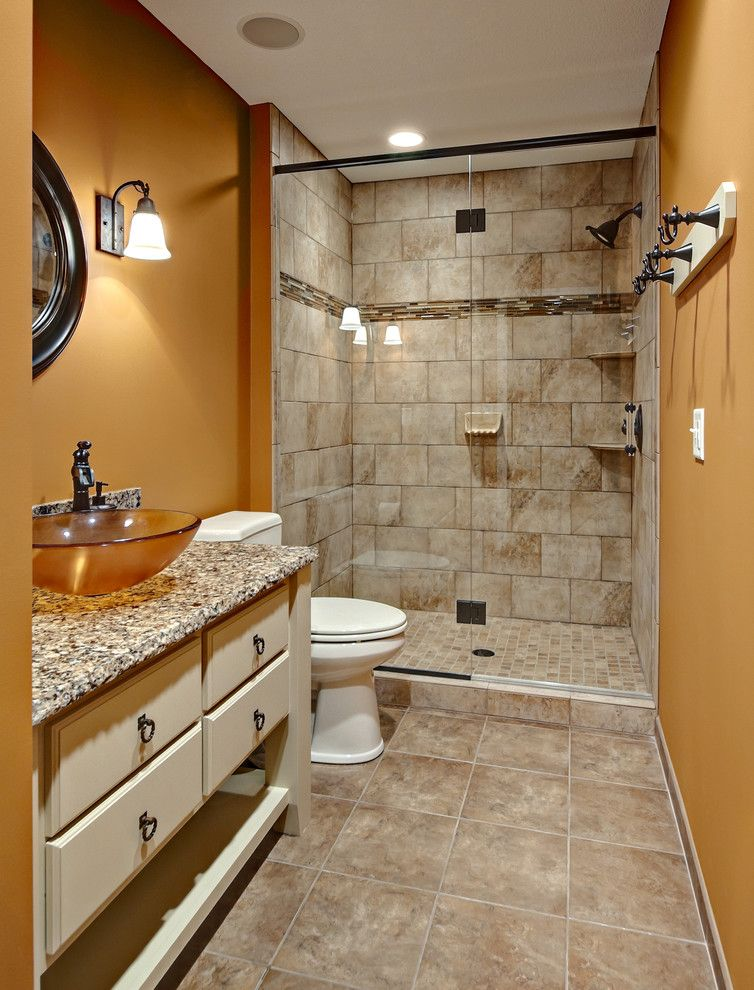 Bathroom Layouts for a Traditional Bathroom with a Golden Walls and Bathroom by Knight Construction Design Inc.