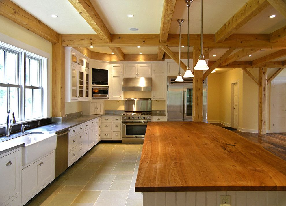 B&b Appliances for a Farmhouse Kitchen with a Glass Front Cabinets and Farmhouse Kitchen by Perkins Smith Design Build