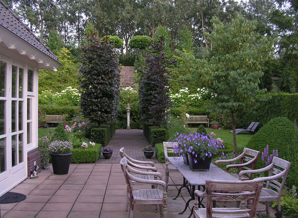 Beautiful Backyards for a Traditional Patio with a Tall Trees and Photo Courtesy of Carla and Rinus Van Lier by houzz.com