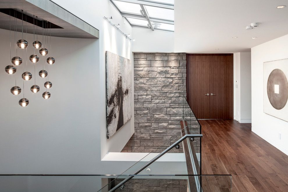 Bedrock Granite for a Contemporary Hall with a Double Door and Waterfront Spectacular by Schmidt Architecture
