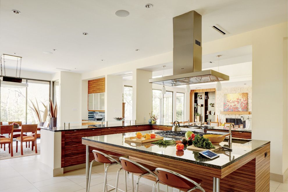 Bedrock Granite for a Modern Kitchen with a Large Kitchen Space and Kitchens by Magnolia Design Center