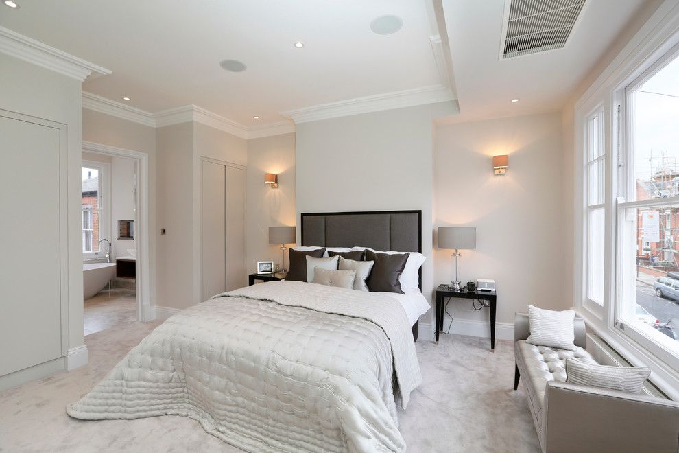 Bedroom Color Schemes for a Contemporary Bedroom with a White Crown Molding and Fulham Refurbs & Extensions by Hartley Homes