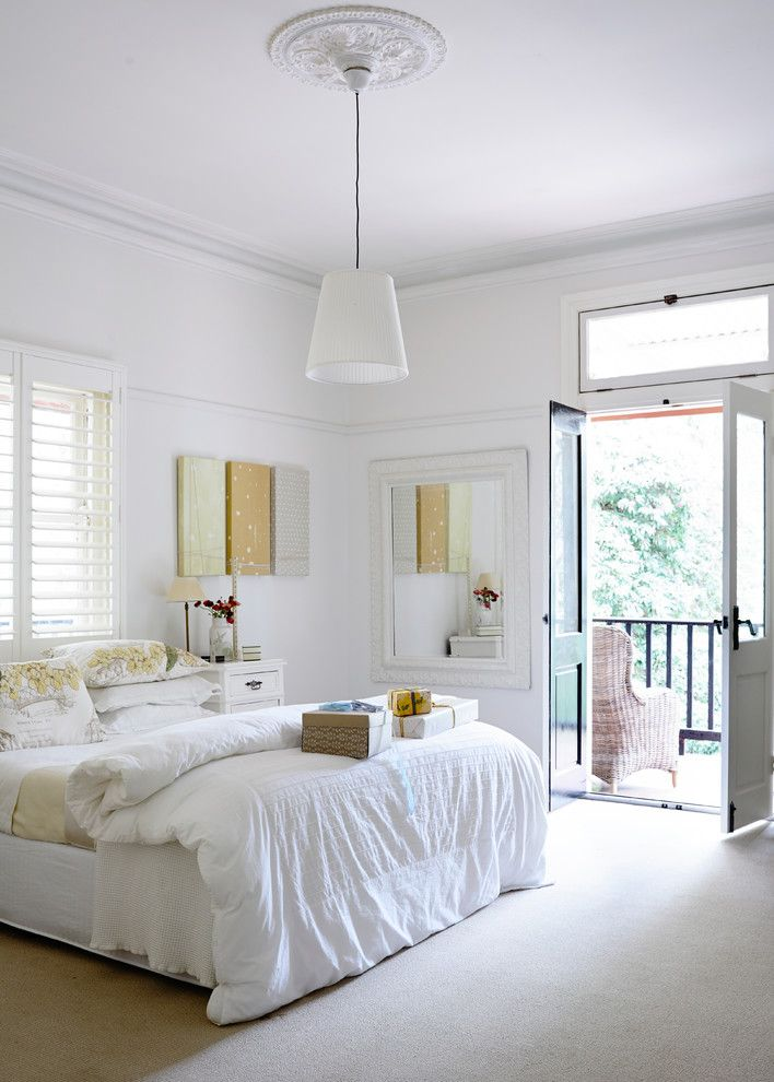 Bedroom Color Schemes for a Transitional Bedroom with a Queen Bed and Guestroom Olinda House by Beautiful South