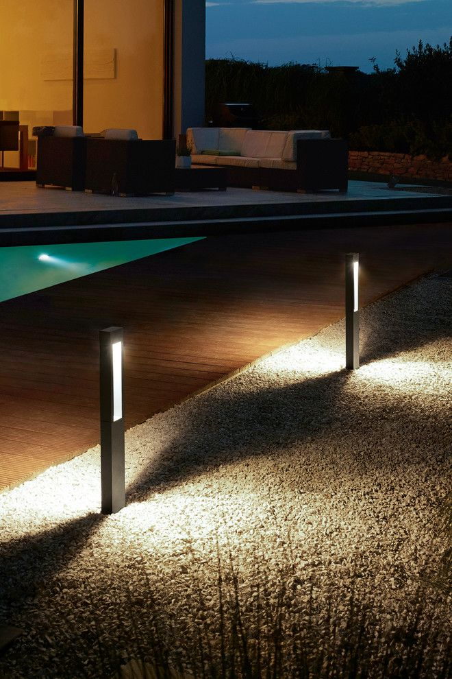 Bega Lighting for a Modern Pool with a Fixture and Landscape Lighting by Bega Us
