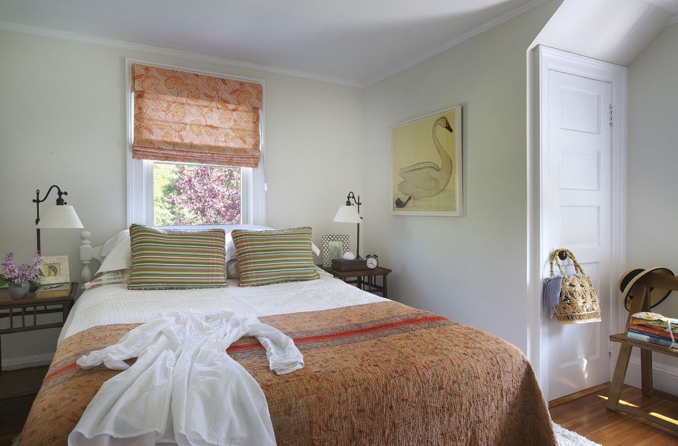 Behr Swiss Coffee for a Beach Style Bedroom with a Beach House Bedroom and Bedroom by Kate Jackson Design
