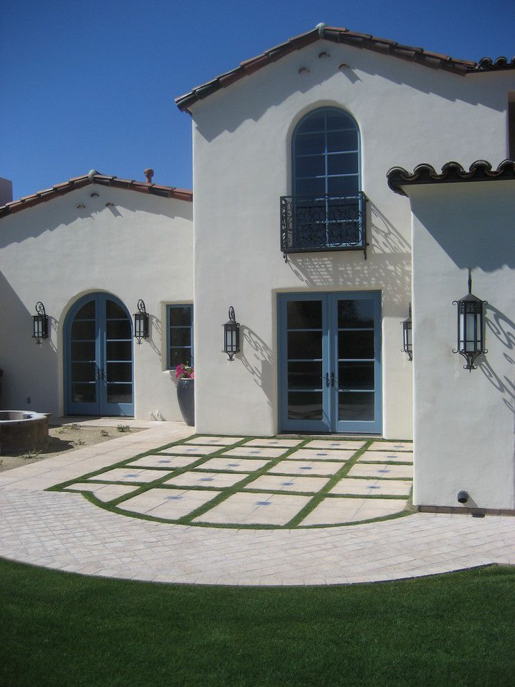 Behr Swiss Coffee for a Mediterranean Exterior with a Blue Door and Carson Poetzl, Inc. by Carson Poetzl, Inc.