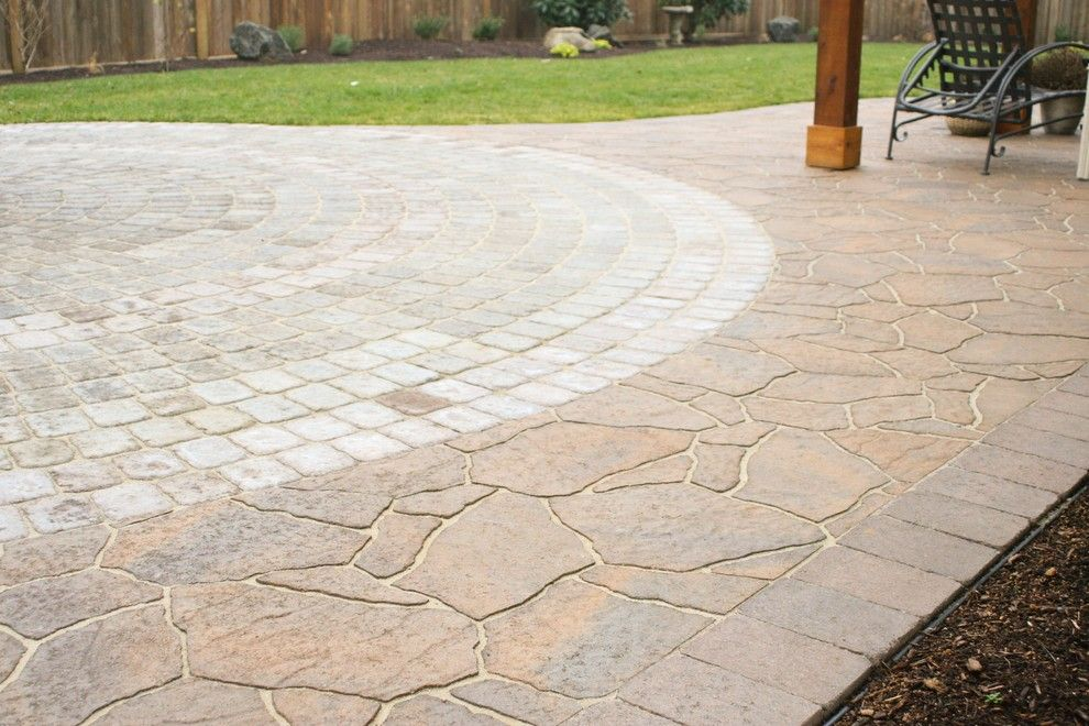 Belgard Pavers for a Craftsman Landscape with a Outdoor Hidden Storage and Belgard Arbel Paver Joined Up to a 24 Foot Wide Paver Circle. by Graham Landscape and Design