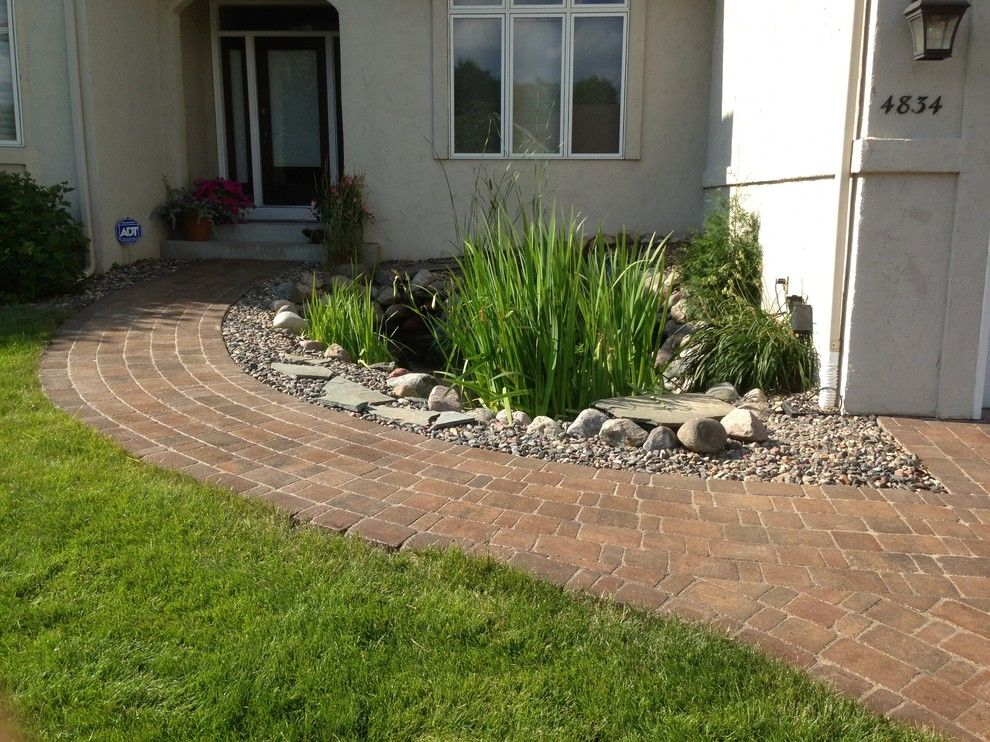 Belgard Pavers for a Traditional Entry with a Pond and Koi Pond with Belgard Paver Walkway by Backyard Paradise Landscaping Llc