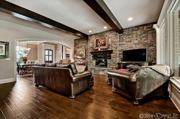 Bella Cera for a Rustic Family Room with a Homes and Sunset Ridge Home by Celtic Custom Homes