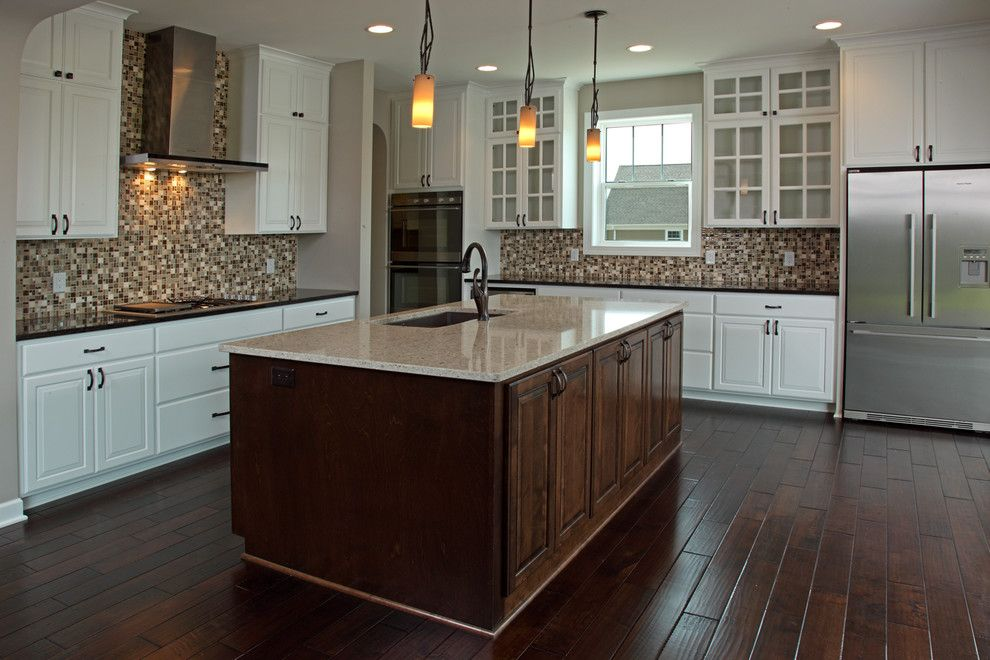Bella Cera for a Traditional Kitchen with a Dark Center Island and Spirit of Brandtjen Farm - Lakeville - Custom Build by Homes by Tradition