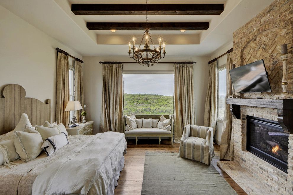 Bella Vita Custom Homes for a Mediterranean Bedroom with a Dark Wood Beams and Rough Hollow by Bella Vita Custom Homes & Remodeling