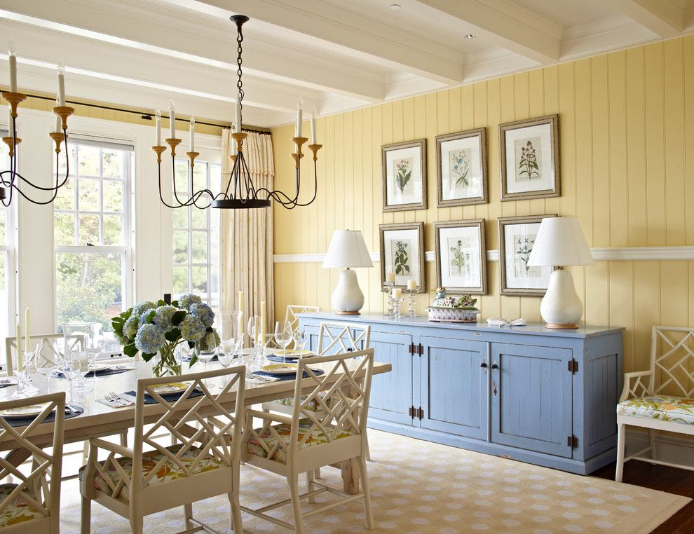 Benjamin Moore Dove White for a Beach Style Dining Room with a White Table Lamp and Michigan Summer Home by Tom Stringer Design Partners