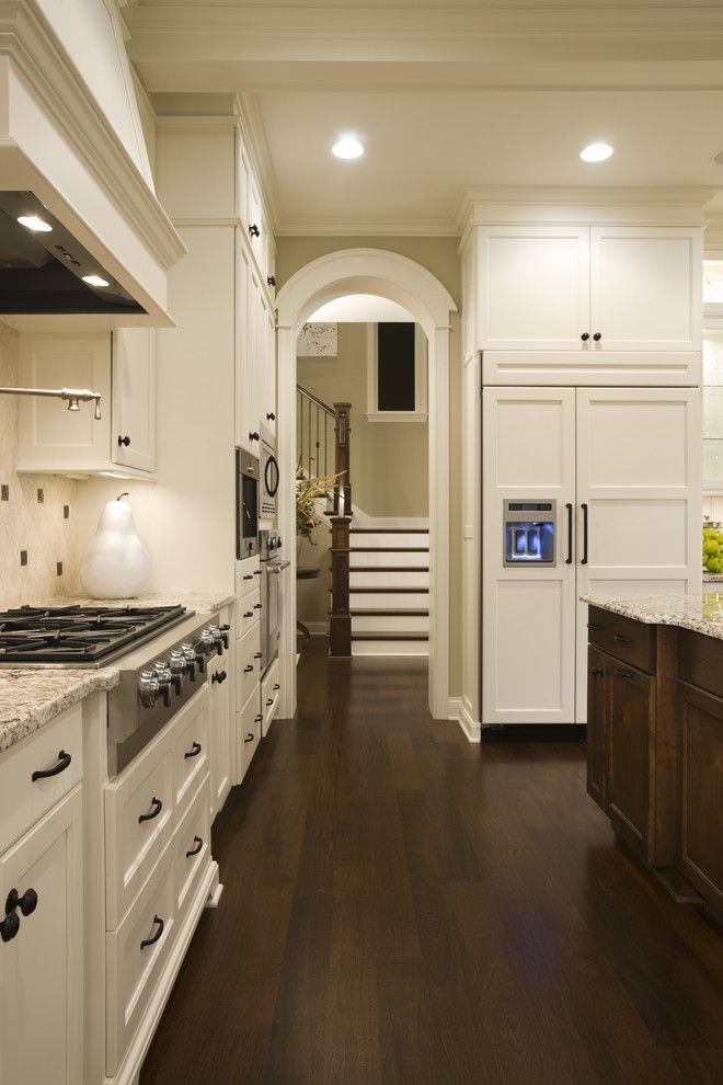 Benjamin Moore Dove White for a Traditional Kitchen with a Dark Floor and Kitchen by Stonewood, Llc