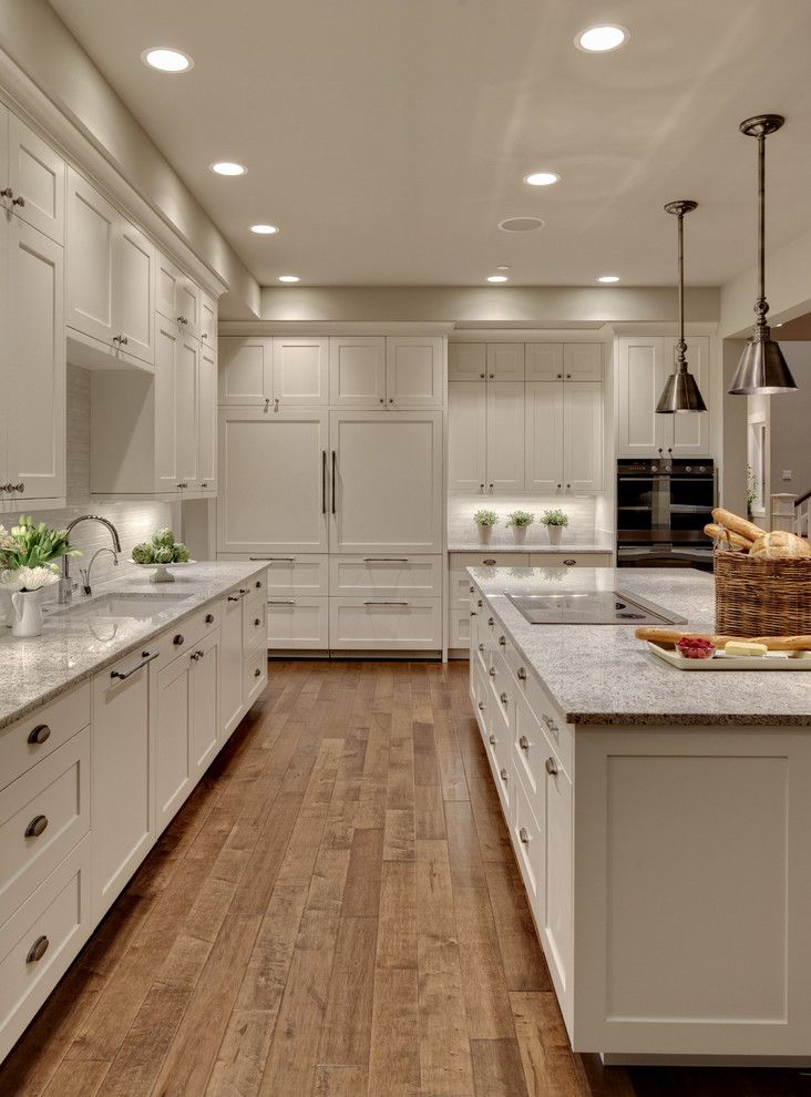 Benjamin Moore Dove White for a Transitional Kitchen with a Engineered Hardwoods and Woodinville Retreat by Studio 212 Interiors