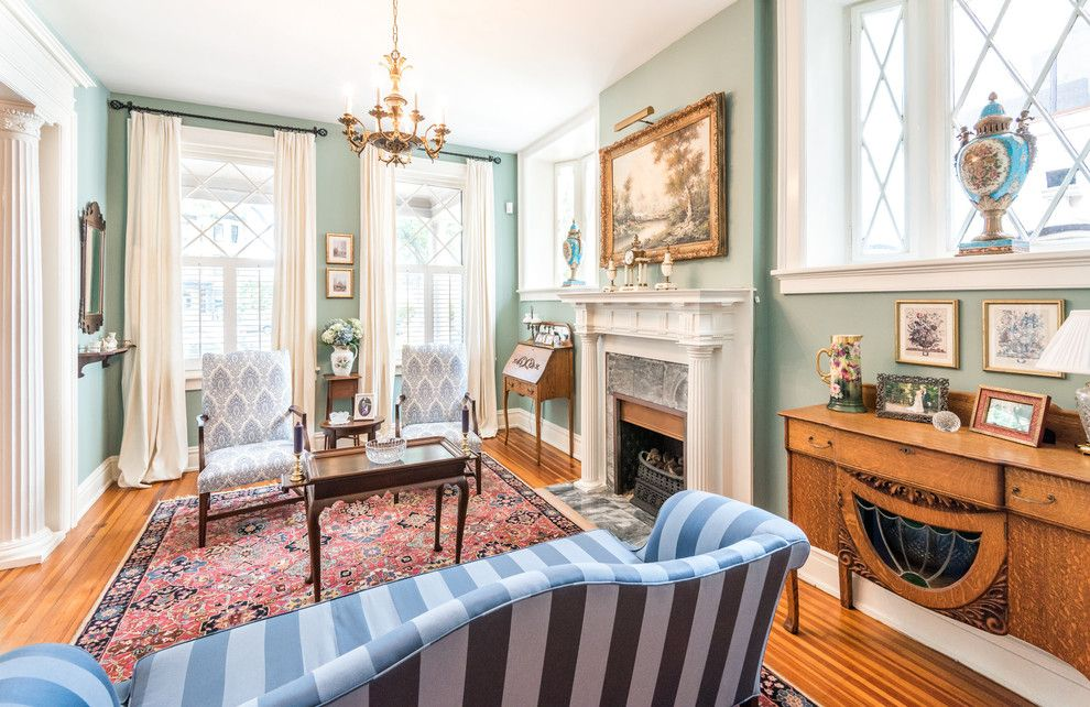 Benjamin Moore Guilford Green for a Traditional Living Room with a Green and Lee Circle by Modern Traditions Interior Design Llc