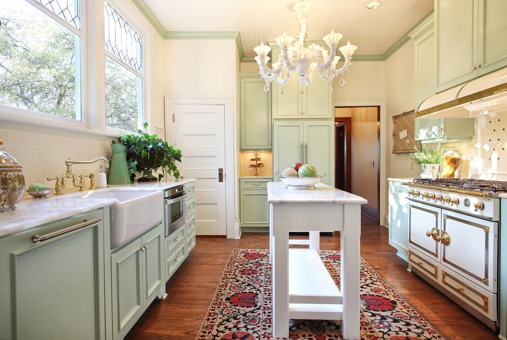 Benjamin Moore Guilford Green for a Victorian Kitchen with a Green Cabinets and Thurman Street by Garrison Hullinger Interior Design Inc.