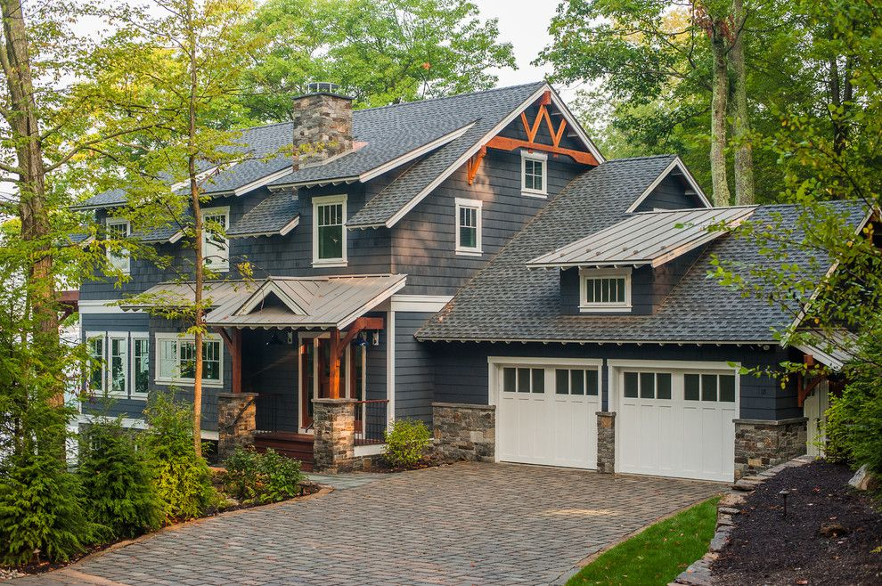 Benjamin Moore Hale Navy for a Rustic Exterior with a Wood Truss and Lake George Retreat by Phinney Design Group