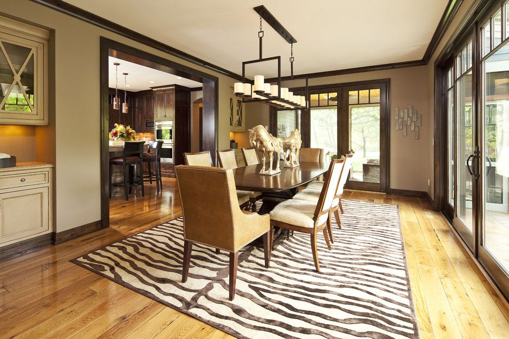Benjamin Moore Manchester Tan for a Contemporary Dining Room with a Sliders and Dining Room by Hendel Homes