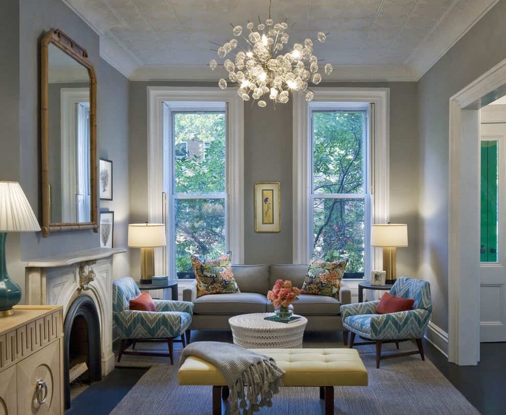 Benjamin Moore Moonshine for a Transitional Living Room with a Limestone Fireplace and Bergen Street Residence by Cwb Architects