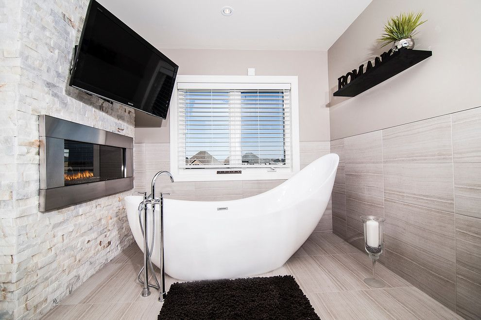 Benjamin Moore Pashmina for a Contemporary Bathroom with a Horizontal Fireplace and Model Home by Drt Custom Homes & Renovations Inc.