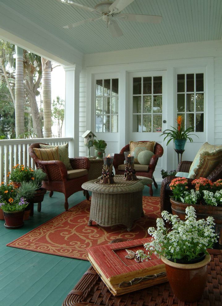 Benjamin Moore Quiet Moments for a Eclectic Porch with a Wicker Chair and Old Florida River House by Island Paint and Decorating