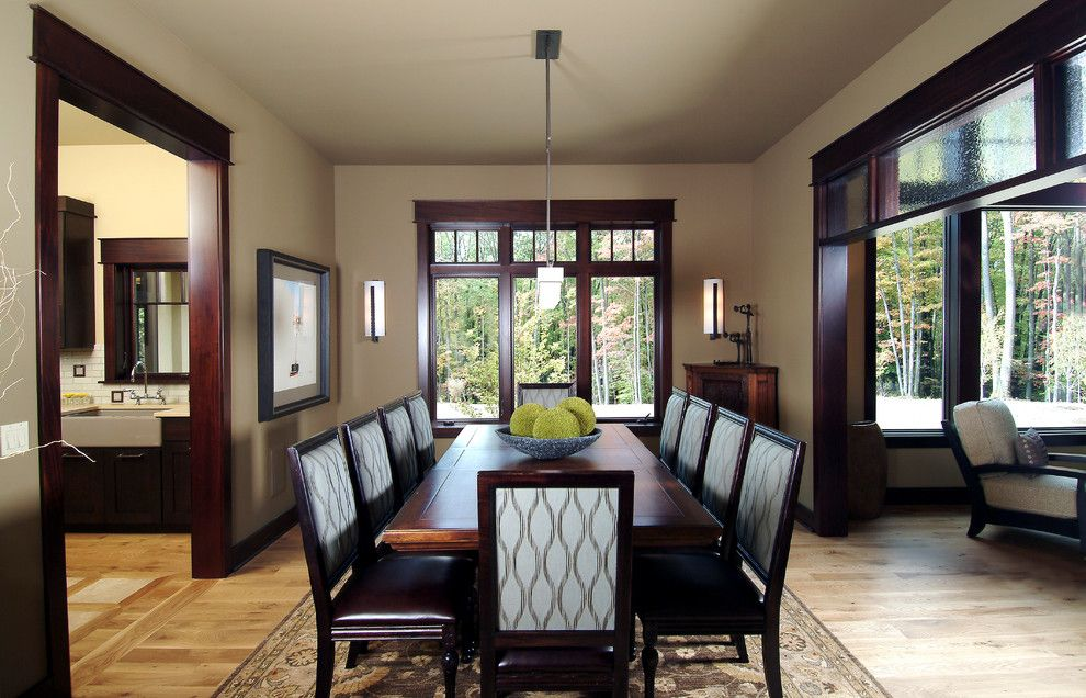 Benjamin Moore Revere Pewter Color Match for a Traditional Dining Room with a Transom Window and Dining Room by Visbeen Architects