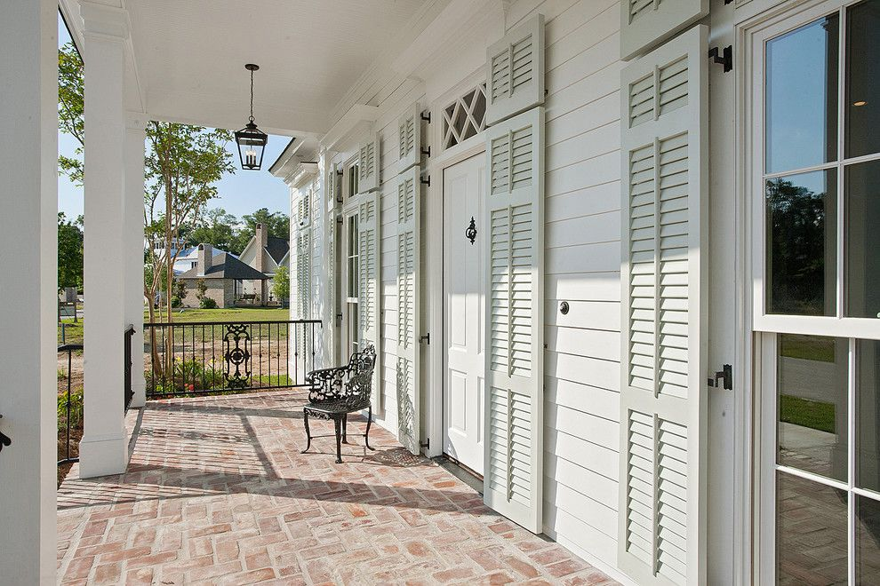Benjamin Moore Sea Salt for a Traditional Porch with a Shutters and New Orleans Charm with a Private Courtyard by Highland Homes, Inc.