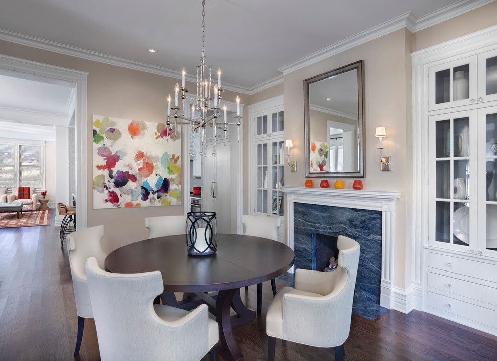 Benjamin Moore Shaker Beige for a Transitional Dining Room with a Wall Sconce and Hyde Park Renovation by Tom Stringer Design Partners