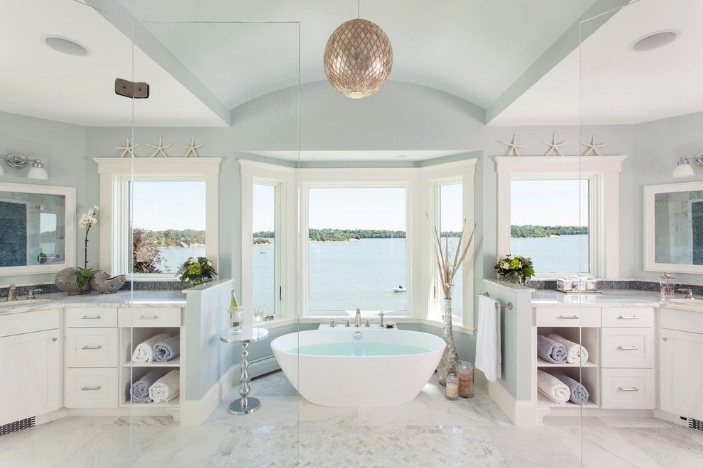 Benjamin Moore Smoke for a Beach Style Bathroom with a Designer Bathroom and a Master Bathroom with a View by Roomscapes Luxury Design Center
